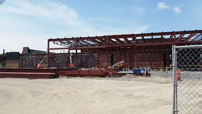 Structural steel and metal deck addition to east side of existing building.