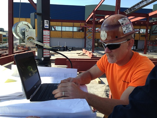 General Foreman, Matt Nesbitt views erection drawings and parts drawings on the laptop right on site!